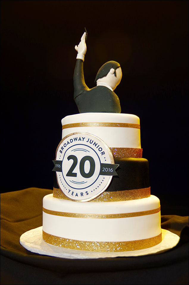 A cake honoring the 20th anniversary of Broadway Junior.