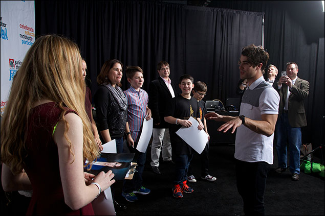 Darren Criss meets students backstage before his concert at the Junior Theater Festival