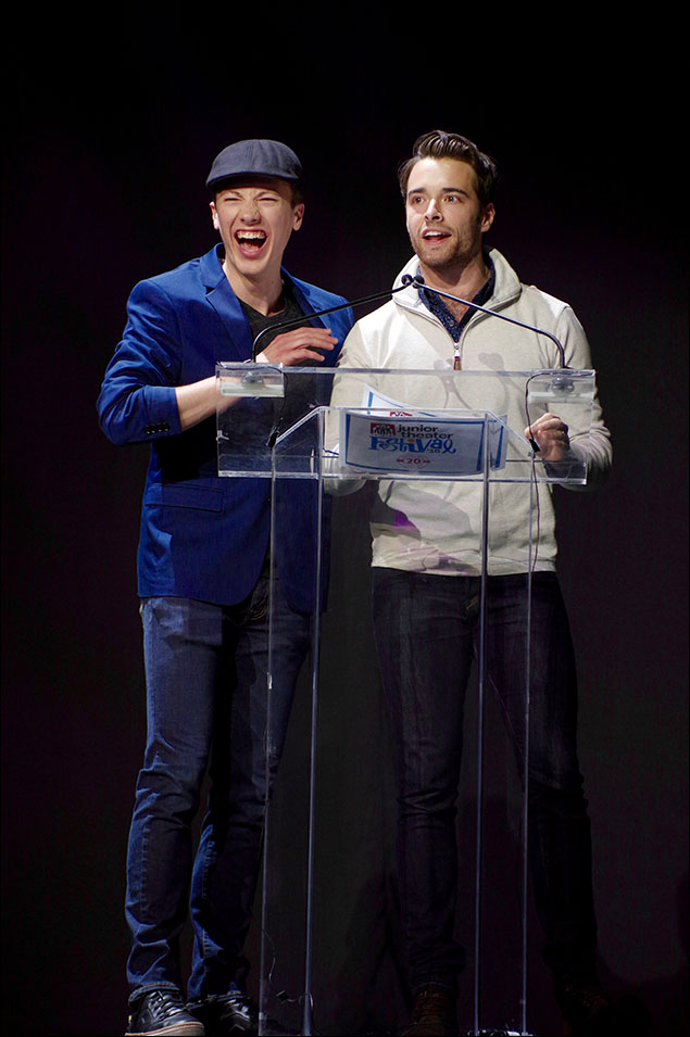 Cory Lingner (On the Town) and Corey Cott (Newsies) present the Freddie G All Festival Performance Female Award to Emma Lord from Ohlook Performing Arts Center in Grapevine, TX.