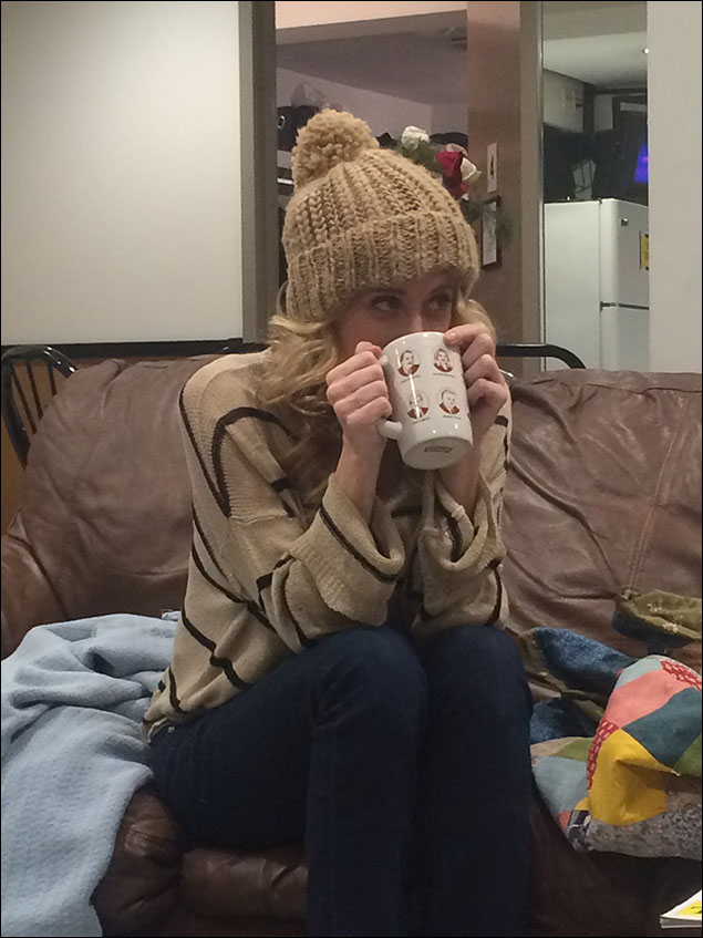 Caissie Levy relaxing with a cup of tea. Note her ironic Republican mug, courtesy of our company managers, Rebecca and Heather.