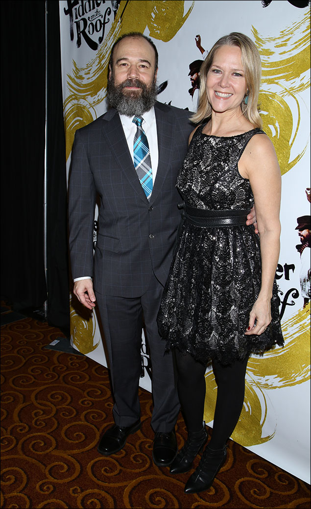 """Star-of-the-show Danny Burstein ruled the night in a classic """"window-pane plaid"""" suit and a cheery argyle plaid tie... with his Tevye whiskers and the Savile row styling, the whole effect was both modern and Edwardian-Christmas at the same time... and what can we say about beautiful Rebecca Luker except that she twinkled!...literally twinkled on Danny's arm in her black and silver lace ensemble with the leggings! A hearty congratulations and the happiest of holidays to everyone who celebrated this great revival! #andScene!"""