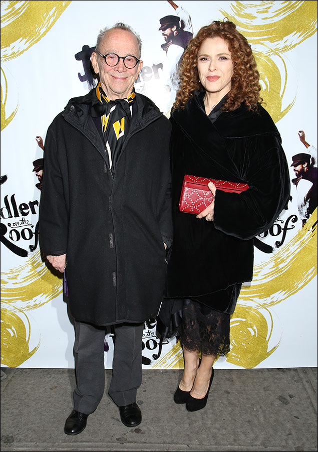 "Bernadette Peters was bundled up cozy and warm on the red carpet, but we were craning our necks to see what that fabulous lace and satin dress was underneath the coat. Leave it to Bernadette to even feature stylish outerwear. There wasn't a red carpet, you say? Bernadette's holly-berry-red clutch more than made up for it! A big ""thank you"" to Ms. Peters for a Broadway season of style and taste at every venue she's graced!"