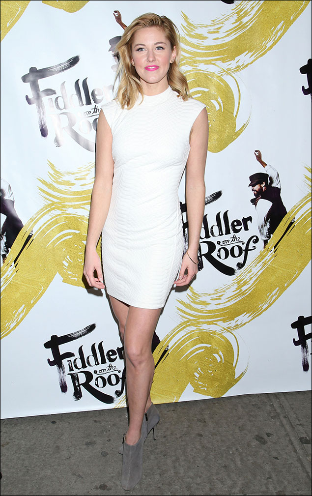 "Taylor Louderman took on the whole ""Winter White"" controversy in her snake-skin-textured mini-dress. Looking like everybody's favorite snow-bunny in those grey suede booties and the sunny-blond hair, she was a lovely flash of light in these shorter days of mid-Winter."