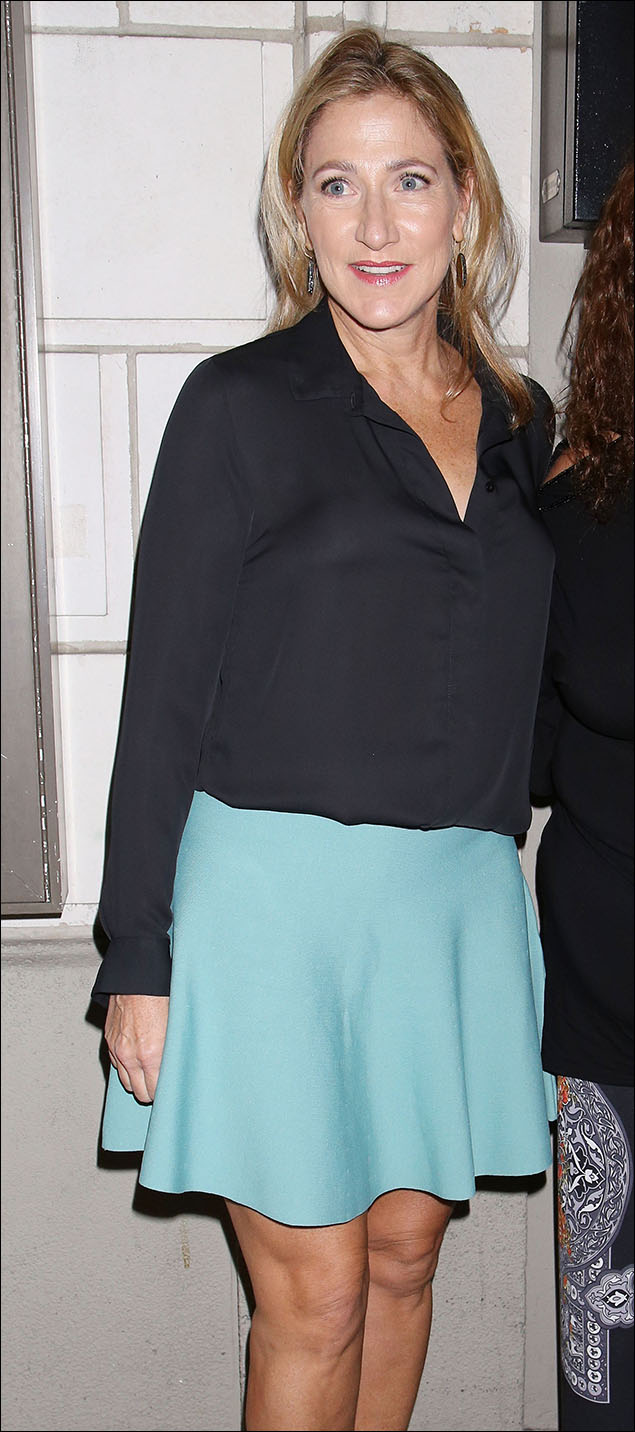 Edie Falco giving us an unexpected mint green in her flirty little skater-skirt! Adorable!!