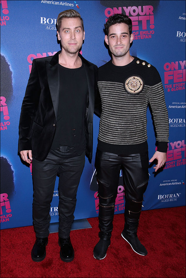 Lance Bass and Michael Turchin! A tux 'n' tee, sexy sweater, zippers, big buttons – the whole thing looked like two perfect club-guys looking cool on their way to Studio 54.