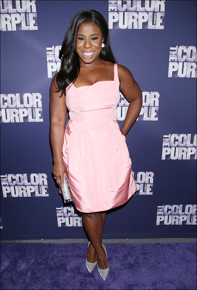 "Uzo Aduba looked like a piece of peppermint candy in her pink satin bubble dress! The pleating and the sculpting of the fabric made it totally modern! I love how Uzo works her lovely fashion sense in total contrast to the character she plays on ""Orange Is the New Black."" No ""Crazy-Eyes"" Warren anywhere to be found when Uzo walks the red carpet! A+"