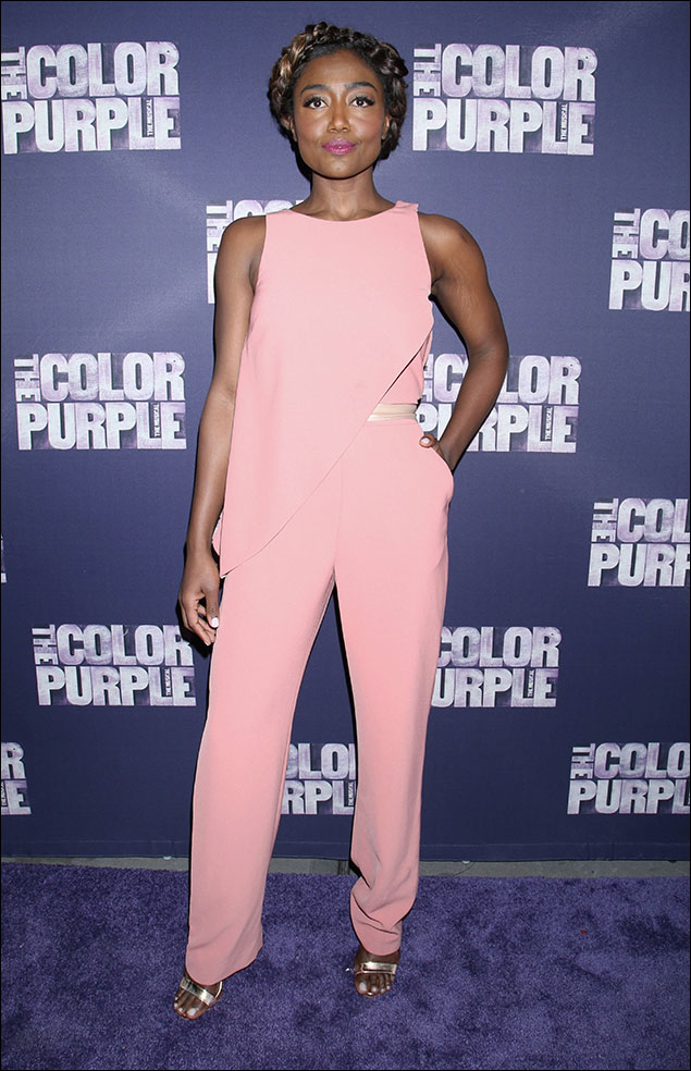 Patina Miller looked light and breezy in her asymmetrical pant-suit in a soft dusty rose. The diagonal line of the tunic-top kept it exciting and oh-so-chic, as did the peak of gold on the belt and those strappy-sandals. And the braided hair.... Patina always looks lovely!