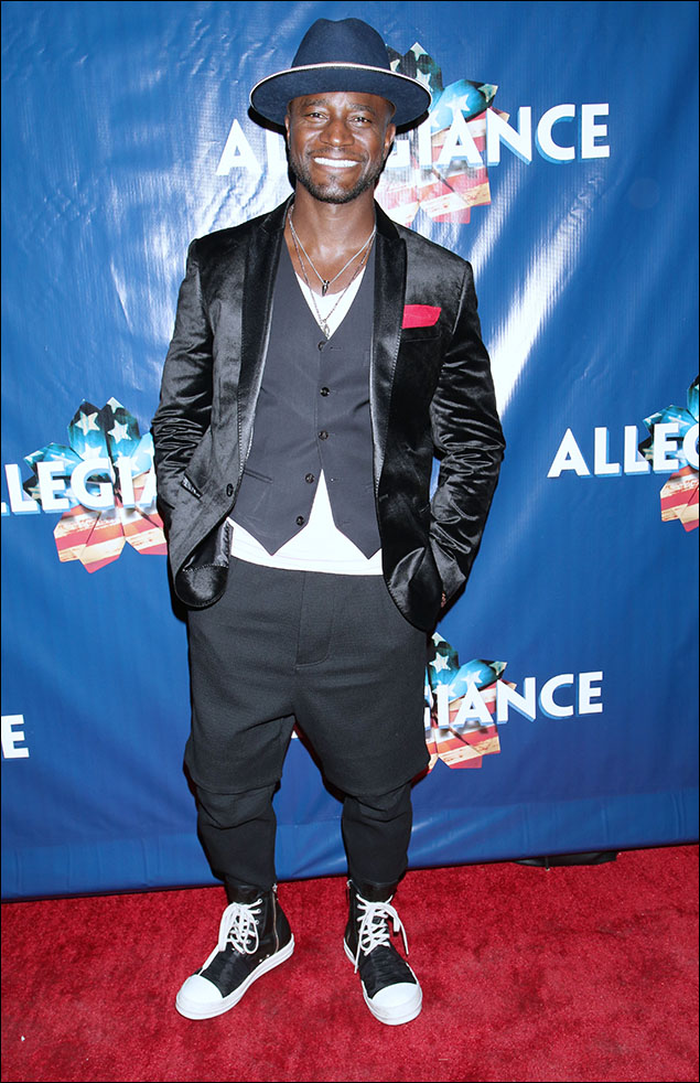 """Taye Diggs brought the """"cool"""" factor to the carpet! Loved his black panne velvet jacket, grey vest and harem pants, all over a white v-neck tee! And those high-tops! OMG!"""