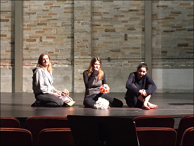 From L to R, Keira Naughton, Nicole Parker, and Ariana Venturi rest during a break on stage.