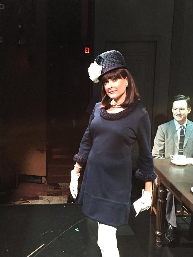 Kate Blumberg looking fabulous as Paulina Noble, as Brad Heberlee looks on.