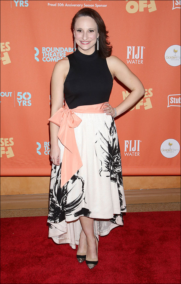 Tracee Chimo showed up in a bold black-and-white ensemble. Simple and sleeveless on top, with an abstract floral print on the asymmetrical hemlined skirt below, and a sash of peach satin tied in a bow at the waist. Chic and refreshing like a spring breeze on an otherwise chilly January night.