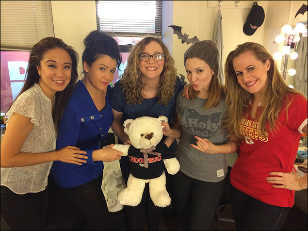Jaygee, Natalie, Emily Cramer, Cassie, and Mamie Parris provide an adequate background for the real star of this photo: the School of Rock teddy bear.