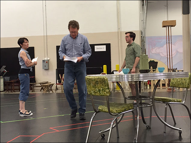 The Hickam family, played by Susan Moniz, David Hess and Nate Lewellyn, rehearsing on our taped-out floor.  The dining set transporting us right back to the 1950s, when our story takes place.