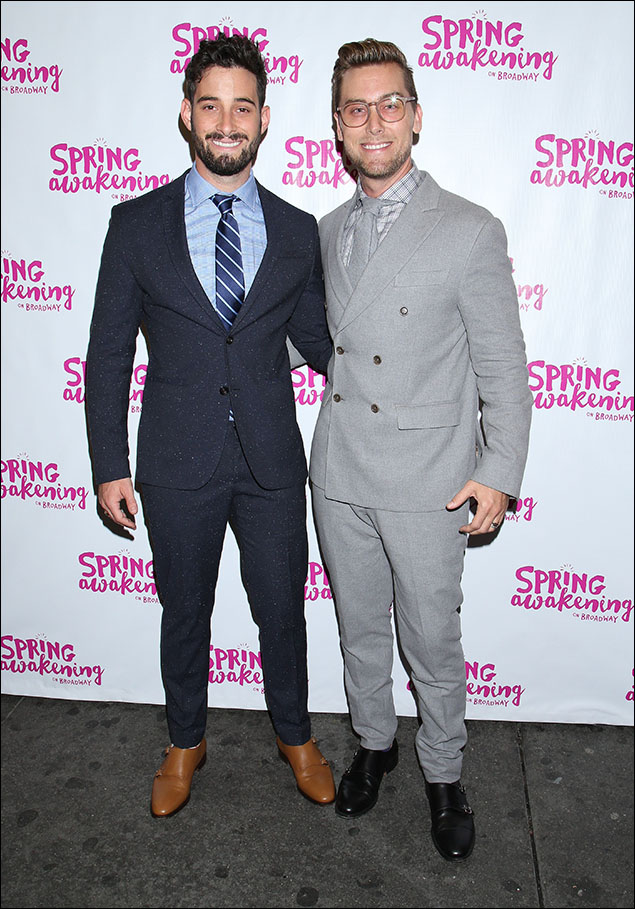 Michael Turchin and Lance Bass both wore updated versions of a classic suit. Michael's was fitted with a striped tie and brown shoe. Lance stood out in fifty shades of grey.