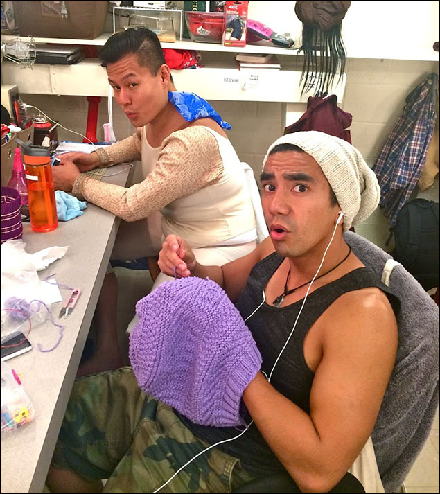 Time to go downstairs and visit with the boys! Kelvin Moon Loh ices his back in preparation for the ballet while Aaron Albano (assistant dance captain and stellar swing) knits a trendy hat (Fun fact: he knitted me the bag that I carry my pre-show Angel Cards in)