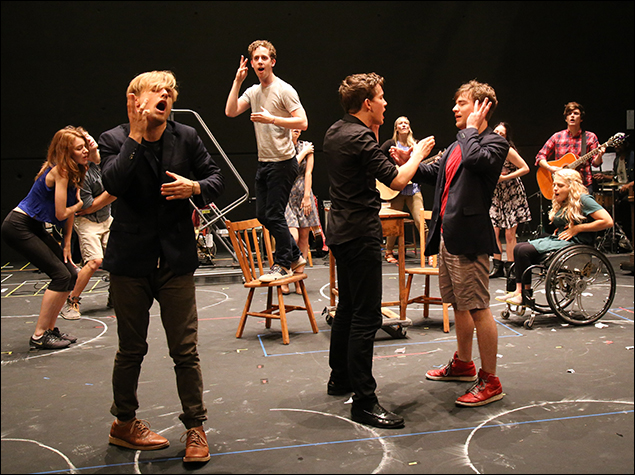 Alex Wyse (on chair) and cast