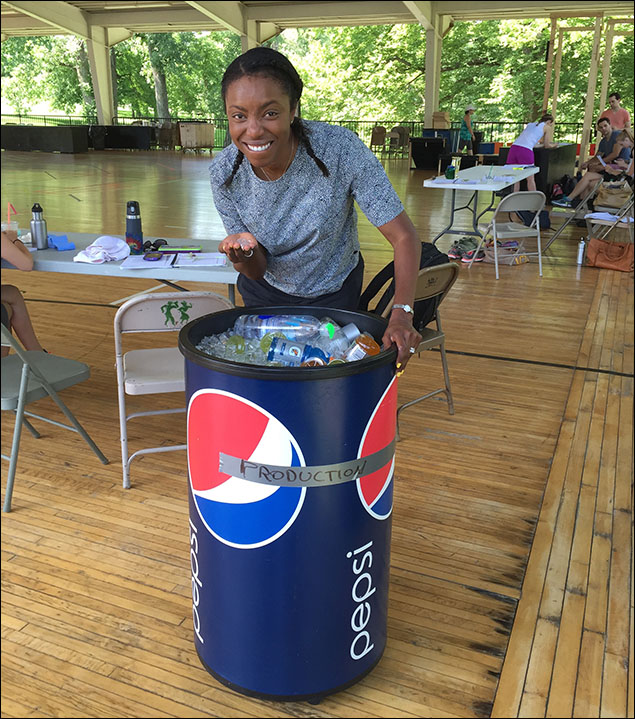 Heather Headley trying to stay cool.  IT's hot here at the MUNY!