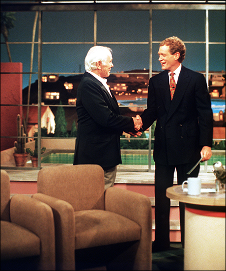 """Johnny Carson in his first and only talk show appearance since stepping down as host of """"The Tonight Show,"""" gets a standing ovation by Letterman and the studio audience when he makes a surprise appearance on May, 13 1994"""