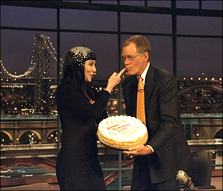 Cher feeds cake to Dave for his birthday, April 12, 1999