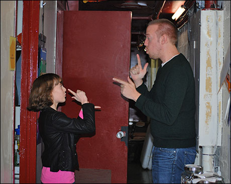 Chris (Music Director) and I head to stage for the kids' warm up after performing our special hand choreography routine.