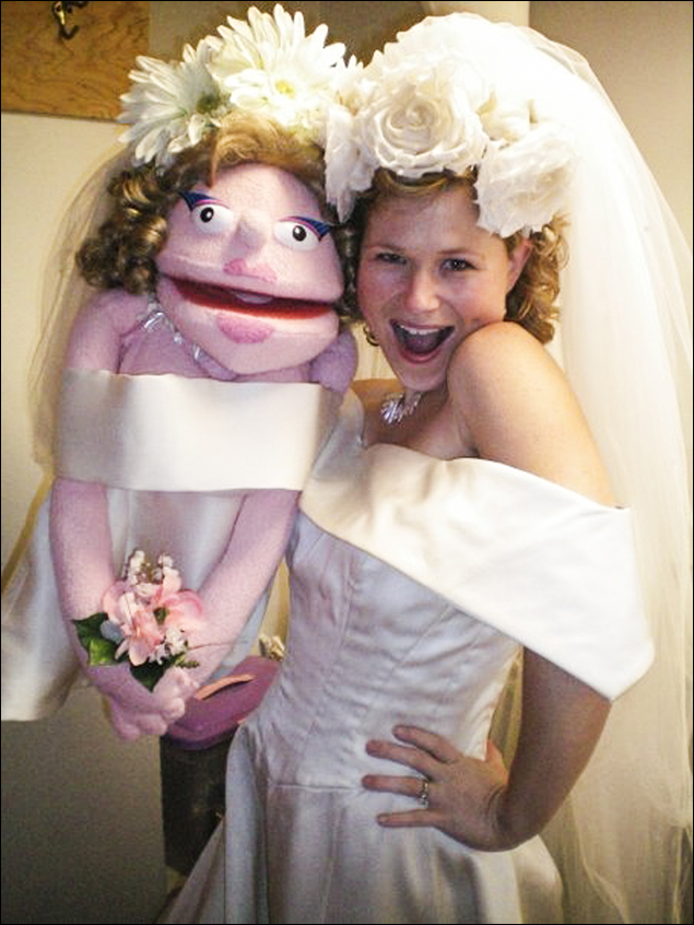 Carey Anderson and her likeness as she prepared to leave for Avenue Q!