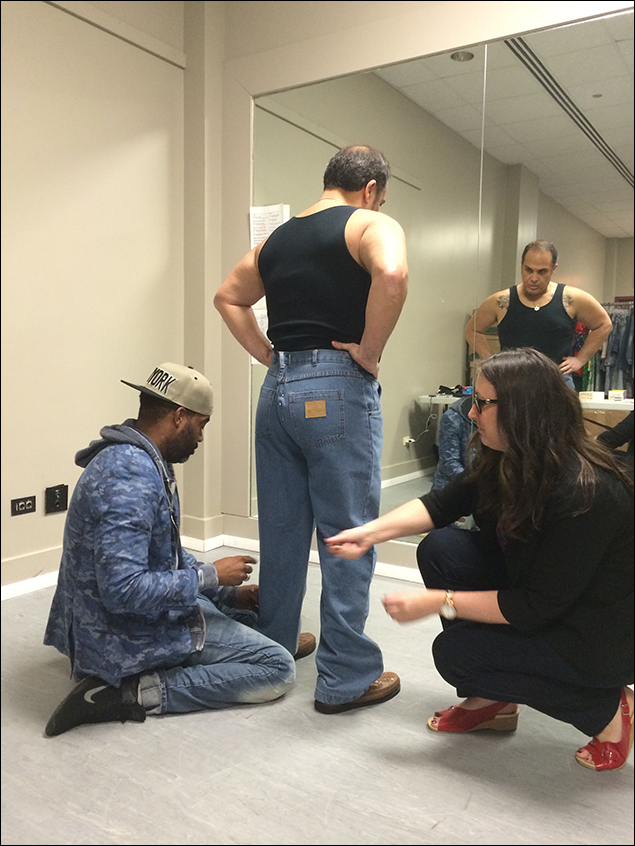 During my lunch break, I was called into a costume fitting. Here's our costume designer Emilio Sosa and and associate costume designer Cathy Parrott fitting cast member Eliseo Roman for a new number that's being added in.