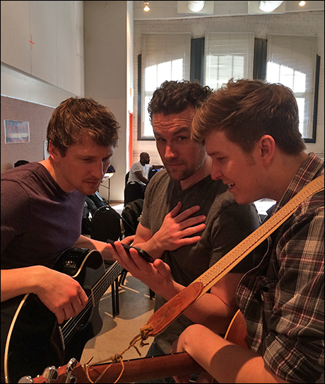 Brad Standley (Phil), Colby Foytik (Jimmy), and Maximilian Sangerman (Thad) going over notes.