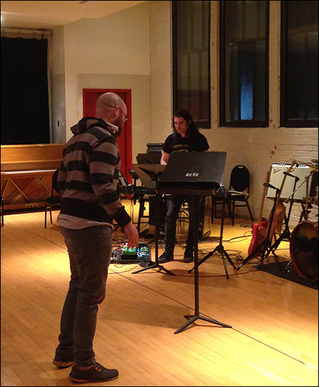 Gregory Treco (Simon) rehearsing with the band.
