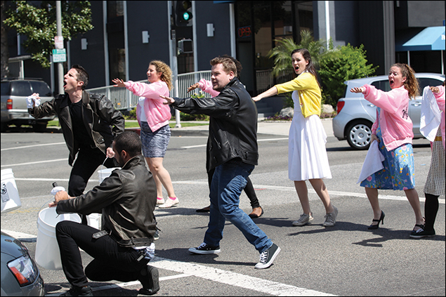 "James Corden (center) performing Grease on the streets of Los Angeles on ""The Late Late Show with James Corden"""