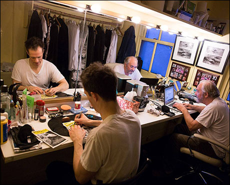 Phantom Broadway's Andre and Firmin, Laird Mackintosh and Tim Jerome, sign Playbills for Broadway Cares/Equity Fights AIDS and stay up on the news of the day online in their dressing room.