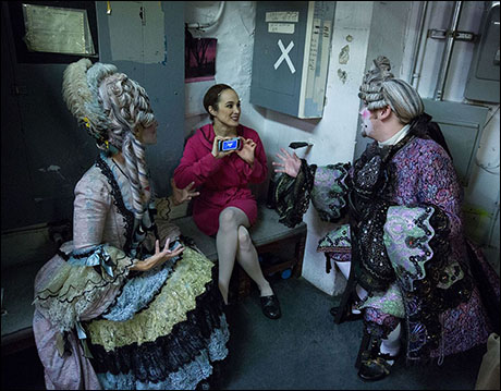 Ensemble members Kelly Jeanne Grant, Elizabeth Welch, and Nathan Morgan enjoy a round of Heads Up during some down time during Act One in the basement under the Majestic Stage.