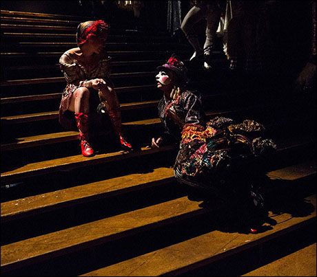 Carly Blake Sebouhian and Kfir relax for a moment on the Masquerade stairs before the second act at Broadway's PHANTOM.