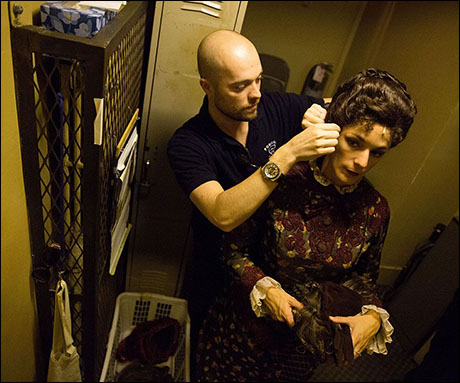 Tyrel Limb removes Gina Lamparella's wig in the stage left stairwell as she changes between the Sitz-Probe and Don Juan.