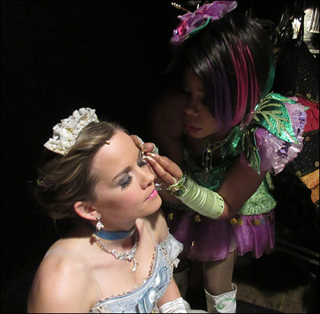 Soara helps Becky with an eyelash. So much love with these ladies.