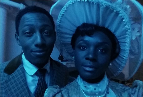 Brandon and I await our entrances, but the blue light in the hallway looks great on our 1910 costumes!