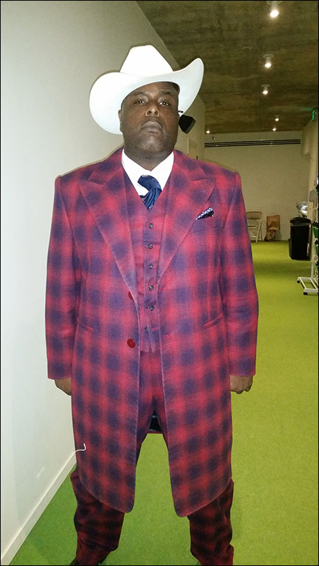 It's our title character Stagger Lee, played by J. Bernard Calloway. He's ready to rumble in his plaid zoot suit!