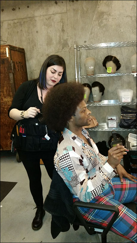 Nicole picks Rickey's afro to perfection.