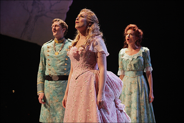 Brandi Burkhardt (center) with Jessica Van Kipp and Dan Beckmann