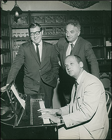 The creators of the musical Golden Boy at work, circa 1963. (Clockwise, from left): Lyricist Lee Adams, book writer Clifford Odets and composer Charles Strouse. Odets never lived to see the opening night.