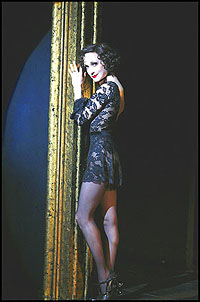 Bebe Neuwirth as Roxie Hart with a piece of the infamous gold frame