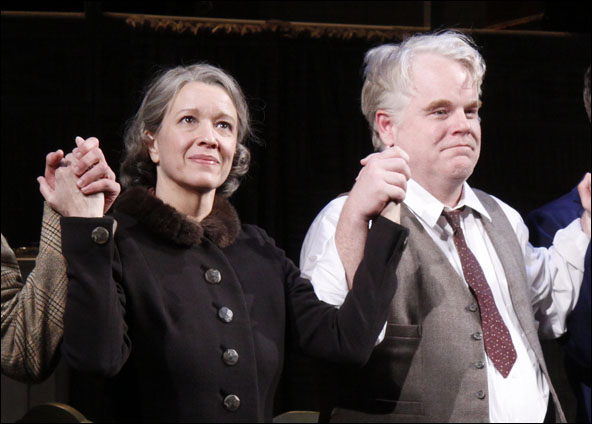 Linda Emond and Philip Seymour Hoffman during the opening night curtain call for the 2012 Broadway revival Death of a Salesman.