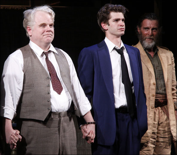 Philip Seymour Hoffman, Andrew Garfield and John Glover during the opening night curtain call for the 2012 Broadway revival Death of a Salesman.