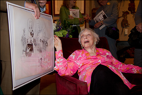 Celeste Holm with a large reproduction of one of Hirschfelds many drawings featuring her likeness.