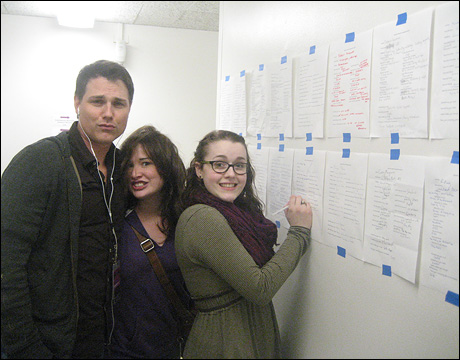 The always beautiful Asa Somers, Emma Hunton and Caitlin Kinnunen causing trouble on the Secret Santa wall.