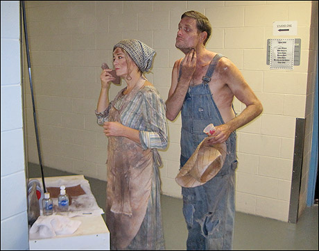 Cumie (Leslie Becker) and Henry (Victor Hernandez) Barrow get down and dirty.
