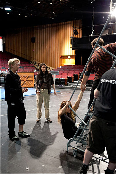 Chet Walker and Diane Paulus work with acrobats Viktoria Grimmy and Gregory Arsenal