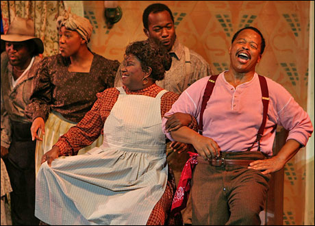 Jo Ann Hawkins White and Michel Bell with the cast of Show Boat