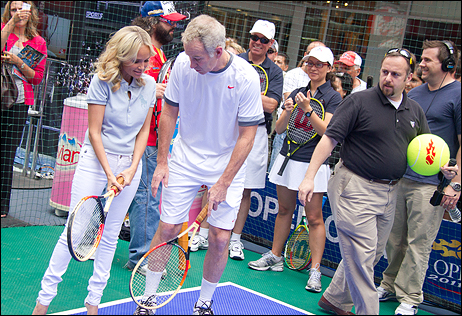 Kristin Chenoweth gets some quick pointers from tennis great John McEnroe