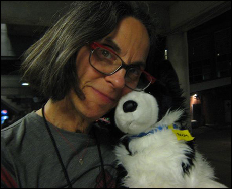 Bonnie Panson (PSM) and prop dog 'Boom' named after the huge Muny 'boom doors.'