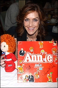 Andrea McArdle signs <i>Annie</i> merchandise